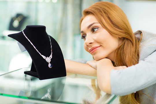 Beautiful woman shopping at the jewelry store