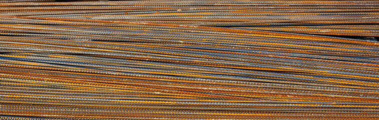 Rusty metal steel reinforcement bars, rods at a construction site