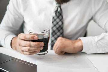Financial Documents business. Close up. Office work with a laptop. Light background. Smartphone in hand Young bearded businessman. Businessman work with Documents on table in office work.