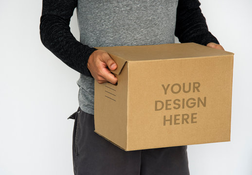 Person Holding Cardboard Box Mockup