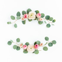 Wall Mural - Wreath frame made of branches eucalyptus, pink ranunculus, roses and leaves isolated on white background. lay flat, top view