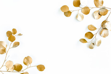 Borders of the frame of gold branches, eucalyptus leaves on a white background. flat layout, top view