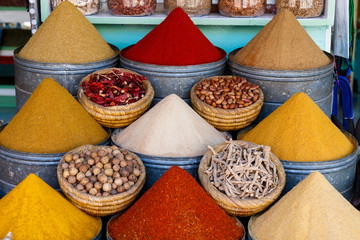Diversity of colorful spices on a bazaar market in Marrakesh Morocco