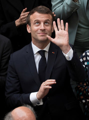 France's President Emmanuel Macron gestures as he poses for a family photo at the International Organisation of La Francophonie (OIF) headquarters in Paris