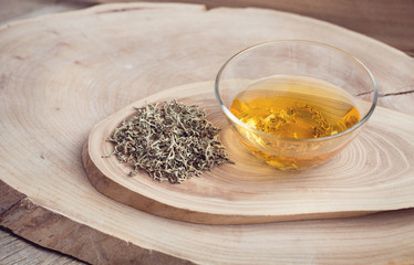 Dry grass and Herbal infusion of moss. On wooden background