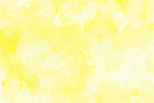 Abstract yellow watercolor on white background.The color splashing in the paper.It is a hand drawn.