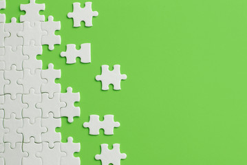 Wall Mural - White details of puzzle on green background