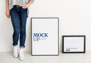 Person Standing Next to 2 Frames Mockup