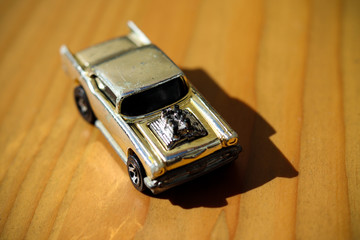 Toy car on a wooden table