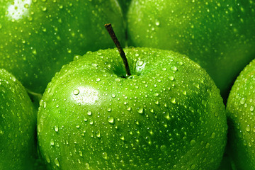 green apple with water drops close-up macro, background Wall mural