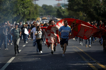 Protesters participate in a demonstration against a water regulation bill, which is believed might lead to the privatisation of water supplies, in San Salvador