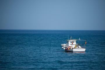 Santorini, August 05, 2015: A Boat alone in the sea