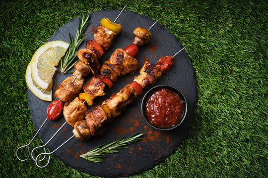 Shish kebab with mushrooms, cherry tomato and sweet pepper, Grilled meat skewers