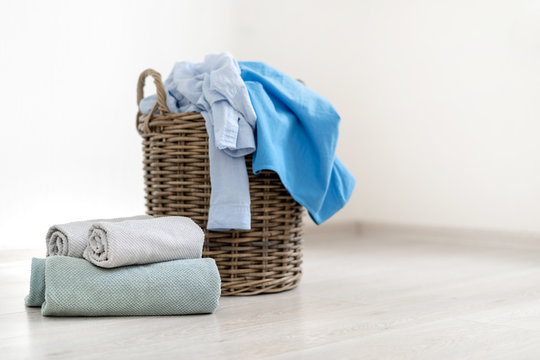Laundry room interior with basket of clothes
