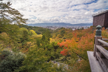 Kyoto Panorama in the distance in autumn from Kiyomizu-dera Buddhist temple in Japan.