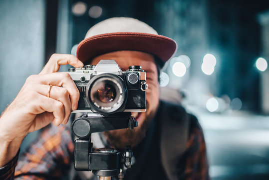 Man taking photo on vintage film camera