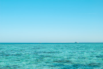 Wide shot of a beautiful clear turquoise sea ocean water surface with low ripples and subtle waves on seascape background, horizontal picture. Vacation travel background with copyspace for your text