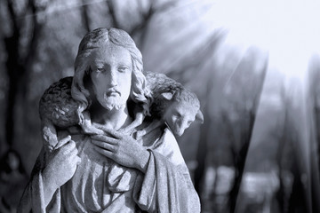 Ancient statue: Jesus Christ is the Good Shepherd with the lost sheep on shoulders.