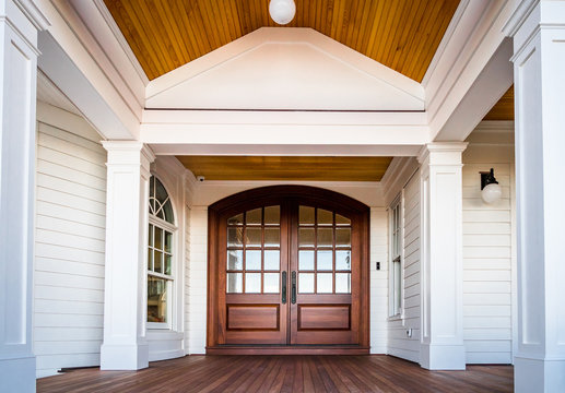 Front entry way of house featuring PVC trim, woodwork, columns, and deck