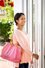 Portrait of a young beautiful hispanic woman shopping.