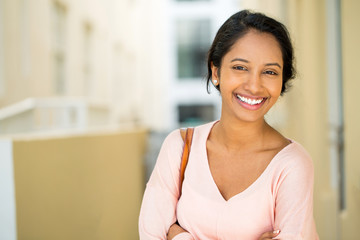 Portrait of a young beautiful hispanic woman smiling.