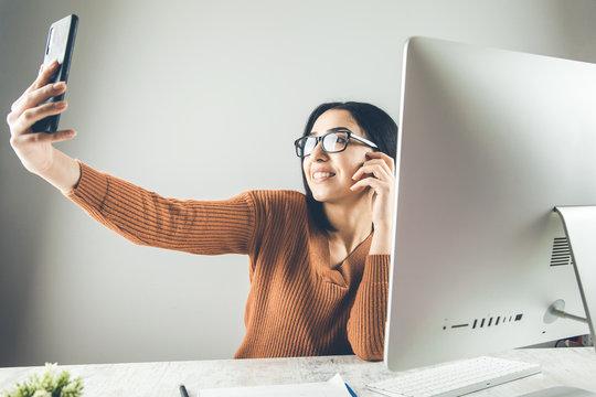 woman hand phone selfie on working desk