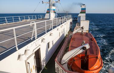 Orange lifeboat on passenger ship
