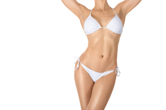 Female sexy tanned fit body in white classic bikini, woman raise her arms up, isolated on white