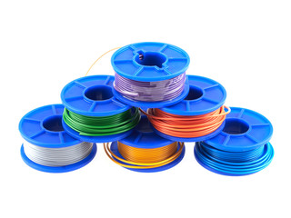 Plastic spools with colorful electric cables
