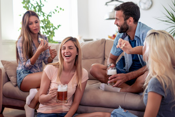 Group of friends enjoying  together at home