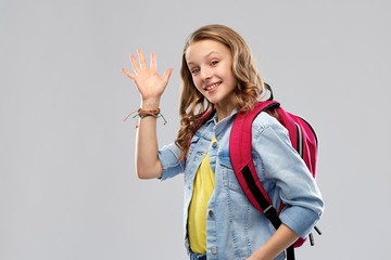 education, school and people concept - happy smiling teenage student girl with bag over grey background
