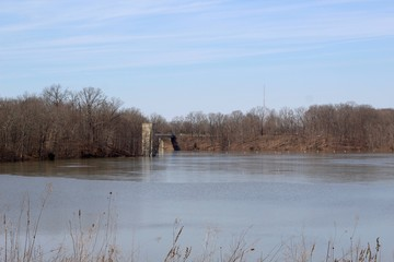 A beautiful view of the lake in the park on a winter day.