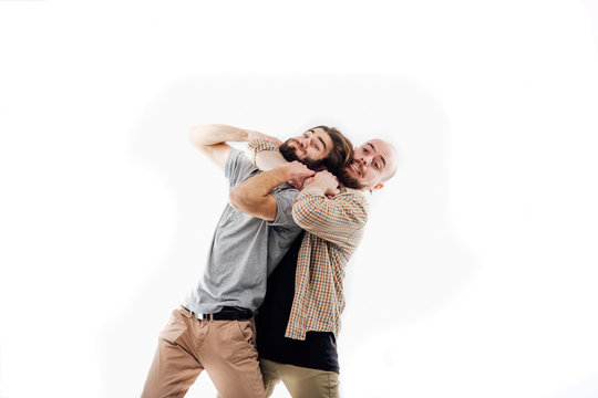 the image of an angry man strangles a man, aggression, wickedness, isolated white background, copy space