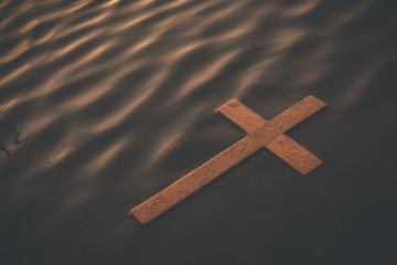 Wooden cross floating on water surface at dawn. Conceptual image baptism