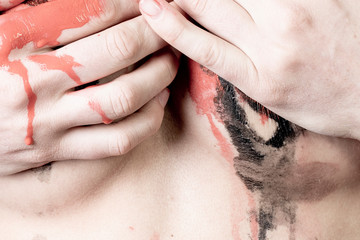 Girl Covers Her Breasts Painted With A Bloody Hand