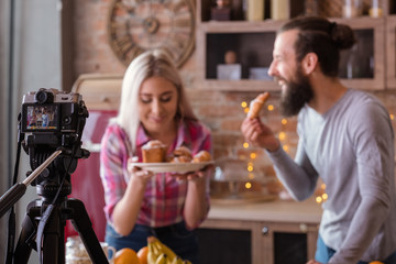 Culinary blog. Baking hobby. Couple shooting video tutorial. Man and woman with fresh cakes and pastries.