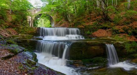 Waterfall under stone bridge in Rhodope mountain near Sitovo village, Bulgaria, Europe, spring photography