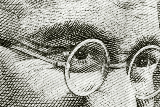 Close up shot of Gandhi on rupee note