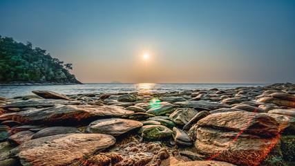 scenery of sunset at rocky beach Wall mural