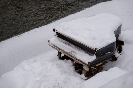 Abandoned piano covered by snow