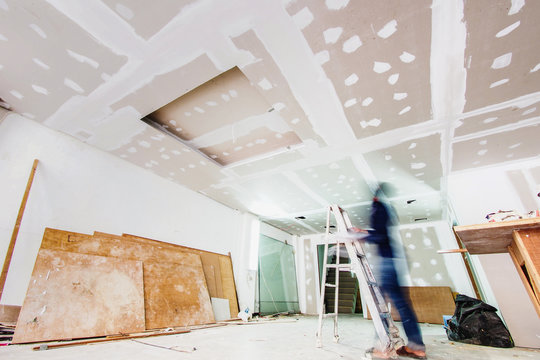 Interior worker working on the ceiling, shot with slow speed shutter