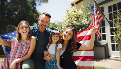 Happy family celebrating the american independence day Wall mural