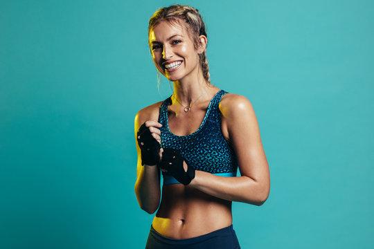 Smiling female fitness model