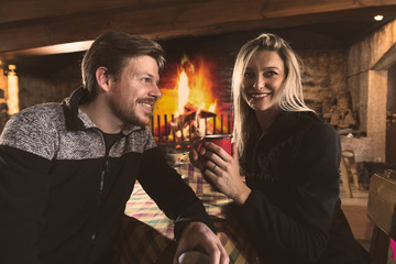 Man and woman drinking tea in cozy place