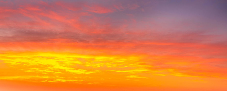 beautiful colorful orange and yellow sunset sky banner background