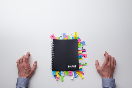 Note pad full of post it notes from above