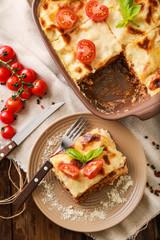 Tasty baked lasagna on table