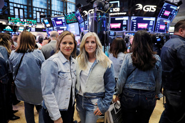 Jennifer Sey, Chief Marketing Officer, and Karyn Hillman, Chief Product Officer of Levi Strauss & Co have their photograph taken during the company's IPO on the floor of the New York Stock Exchange (NYSE) in New York