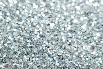 Silver glitter texture. Festive sparkling sequins background. Wpaper for Valentine, New Year or...