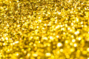 Gold glitter texture. Festive sparkling sequins background. Wpaper for Valentine, New Year or...